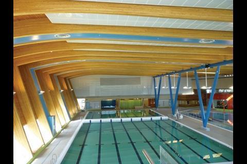 The Douglas fir glulam beams span the 50m pool